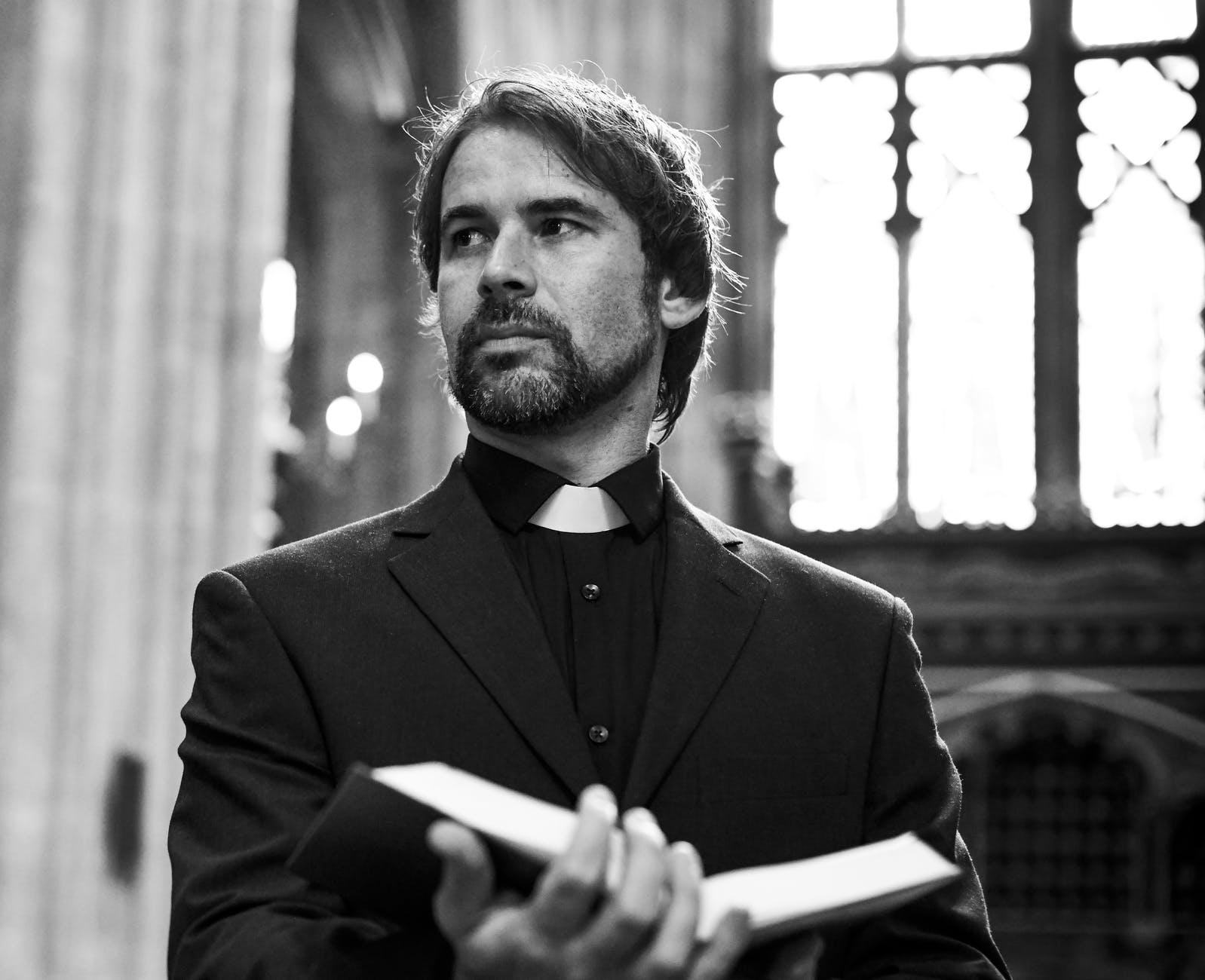 priest-open-bible